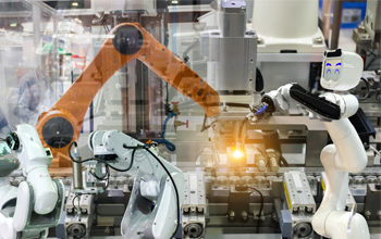 Robots working together in a production line