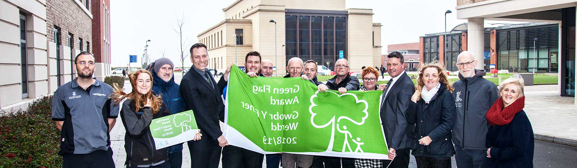 Grounds Team receiving the Green Flag at the Bay Campus