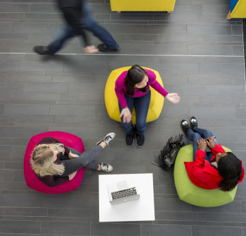 Ariel view of three students chatting.